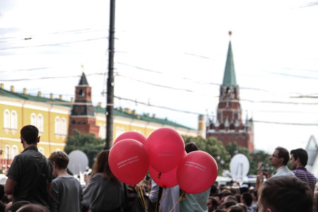 labeled: Moscow, Russia - July 18, 2013. Balls labeled Change Russia, start with Moscow on the opposition rally. Thousands of Muscovites went on this day in support of arrested opposition leader Alexei Navalny Editorial