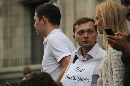 opposition: Moscow, Russia - July 18, 2013. Unknown opposition with the inscription Brother Navalny. Thousands of Muscovites went on this day in support of arrested opposition leader Alexei Navalny