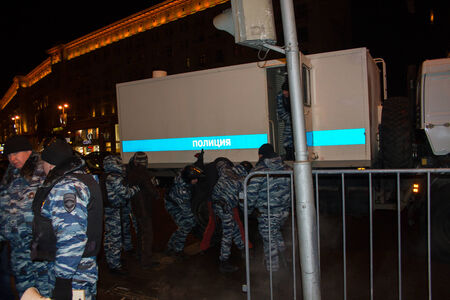 detain: Moscow, Russia - December 30, 2014. In day of a sentence to the oppositional leader Alexei Navalny and his brother Oleg Navalny Muscovites came to a protest action to Manezhnaya Square. Police officers detain protesters in Moscow Editorial