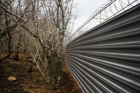 ecologists: Krasnodar region, Russia - March 23, 2012. Fence villas Governor Tkachev in the protected forest with trees, listed in the Red book Editorial