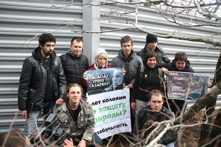 Krasnodar region, Russia - March 23, 2012. Action of ecologists in support of Suren Gazaryan, near a fence of a cottage of the governor Tkachyov in the protected wood Editorial