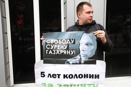 ecologists: Tuapse, Krasnodar region, Russia - March 23, 2012. politician Nikolay Lyaskin on picket in support of the arrested ecologist Suren Gazaryan