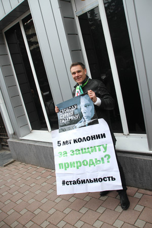 ecologists: Tuapse, Krasnodar region, Russia - March 23, 2012. Ecologist Evgeny Vitishko on picket in support of the arrested ecologist Suren Gazaryan