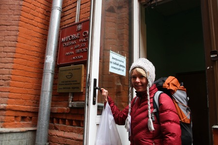 ecologist: Moscow, Russia - April 10, 2012. The ecologist Evgenia Chirikova with the things prepared for arrest on an entrance to the courthouse. The politician was judged for that that it together with the politician Nikolay Lyaskin placed protest tent into Red Squ Editorial