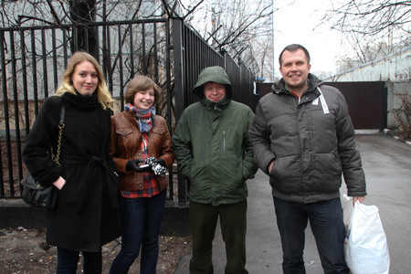 under arrest: Moscow, Russia - April 13, 2012. The politician Nikolay Lyaskin who is just released from under arrest is photographed against prison with the political activists meeting him. Among meeting Konstantin Lebedev and Olga Pakhtusova. Lyaskin was arrested for
