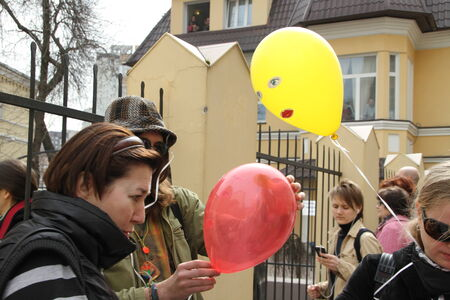 unauthorized: Moscow, Russia - April 19, 2012. Near the building of the Khamovniki court to an unauthorized action there were supporters of the verdict of not guilty for arrested. olitical activists distribute the balloons symbolizing the arrested participants of Pussy Editorial