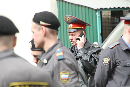 unauthorized: Moscow, Russia - April 19, 2012. Near the building of the Khamovniki court to an unauthorized action there were supporters of the verdict of not guilty for arrested. olice officers near the courthouse where case of Pussy Riot is heard