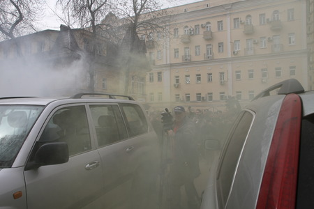opponents: Moscow, Russia - April 19, 2012. Opponents of Pussy Riot sprayed gas among crowd of supporters of the arrested muzakant, the audience near court. . Near the building of the Khamovniki court to an unauthorized action there were supporters of the verdict of