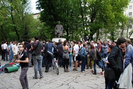 to tease: Moscow, Russia - May 8, 2012. Protesting against violations on elections the opposition occupied the square tease a monument to the poet to Abay, this movement received the name of Okkupay Abay Editorial