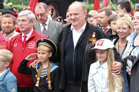 communists: Moscow, Russia - May 9, 2012. March of communists on the Victory Day. The leader of communist party of Russia Gennady Zyuganov is photographed with children