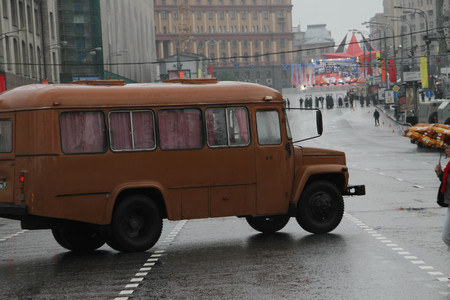 communists: Moscow, Russia - May 9, 2012. March of communists on the Victory Day. Retro the bus on streets of Moscow in day of procession of communists