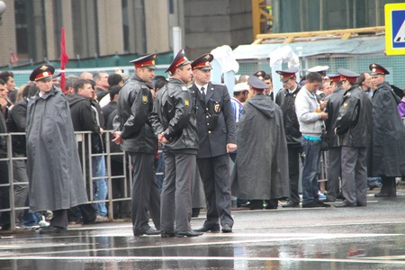communists: Moscow, Russia - May 9, 2012. March of communists on the Victory Day. The Russian police during a rain, near procession of communists Editorial