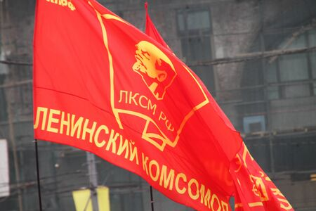 communists: Moscow, Russia - May 9, 2012. March of communists on the Victory Day. Flag of Komsomol during procession of communists
