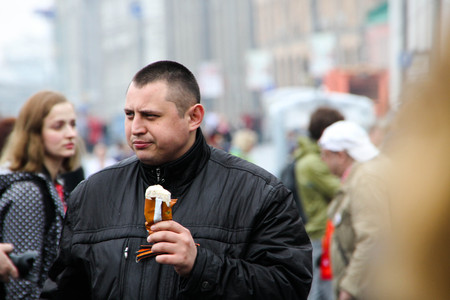 communists: Moscow, Russia - May 9, 2012. March of communists on the Victory Day. Police officer of the Center for fight against extremism Alexey Okopny