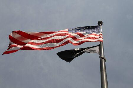 yankees: Washington DC, USA - may 13, 2012. Stars and stripes USA flag on a city street Editorial