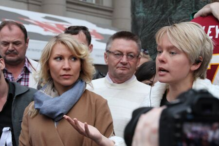 ecologist: Moscow, Russia - on May 27, 2012. The ecologist Evgenia Chirikova speaks at an oppositional action, the politician Alyona Popova nearby. After disputable elections the opposition organized many protest actions on streets of Moscow. This meeting - public p