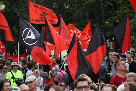 oppositional: Moscow, Russia - July 26, 2012. Flags of anarchists and left on oppositional meeting. The first meeting in protection of the prisoners arrested for protest events on Bolotnaya Square on May 6, 2012 in Moscow Editorial
