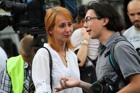 oppositional: Moscow, Russia - July 26, 2012. The photographer Maria Turchenkova looks at the colleague on oppositional meeting. The first meeting in protection of the prisoners arrested for protest events on Bolotnaya Square on May 6, 2012 in Moscow