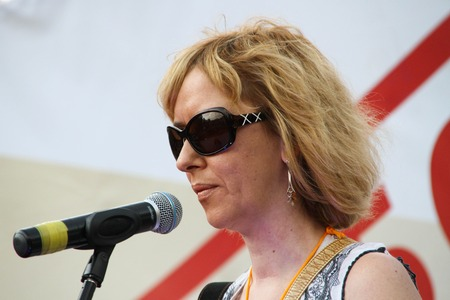oppositional: Moscow, Russia - July 26, 2012. The human rights activist Anna Karetnikova supports political prisoners on oppositional meeting. The first meeting in protection of the prisoners arrested for protest events on Bolotnaya Square on May 6, 2012 in Moscow