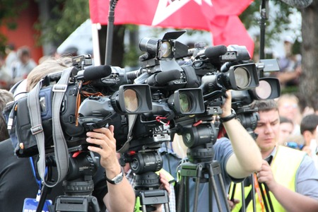 oppositional: Moscow, Russia - July 26, 2012. Television cameras of operators on oppositional meeting, one camera with a St.Georges Ribbon. The first meeting in protection of the prisoners arrested for protest events on Bolotnaya Square on May 6, 2012 in Moscow