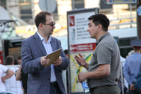 dictatorship: Moscow, Russia - July 26, 2012. Lawyer Nikolay Polozov and human rights activist Sergey Davidis. The first meeting in protection of the prisoners arrested for protest events on Bolotnaya Square on May 6, 2012 in Moscow Editorial