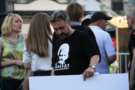 political prisoner: Moscow, Russia - July 26, 2012. The human rights activist Yury Dzhibladze in a t-shirt in support of the Belarusian political prisoner Ales Belyatsky. The first meeting in protection of the prisoners arrested for protest events on Bolotnaya Square on May