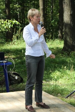 opposition: Khimki, Moscow region, Russia - August 19, 2012. Policies Evgeniya Chirikova speaks to activists in Khimki forest. Representatives of different political forces gathered to propose the single candidate from opposition on elections in Khimki - to Evgenia C