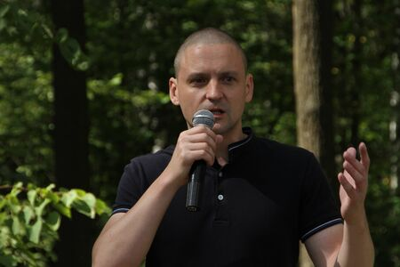 Khimki, Moscow region, Russia - August 19, 2012. The leader of the Left front Sergei Udaltsov at a meeting of activists in the Khimki forest. Editorial