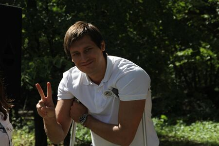 despite: Khimki, Moscow region, Russia - August 19, 2012. Deputy Dmitry Gudkov, despite recent injury, came to the meeting of activists in Khimki forest. Representatives of different political forces gathered to propose the single candidate from opposition on elec