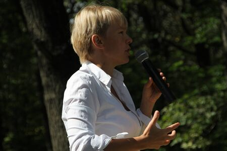 activists: Khimki, Moscow region, Russia - August 19, 2012. Policies Evgeniya Chirikova speaks to activists in Khimki forest. Representatives of different political forces gathered to propose the single candidate from opposition on elections in Khimki - to Evgenia C