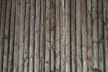 untreated: Wooden old untreated poles thick wall with natural background