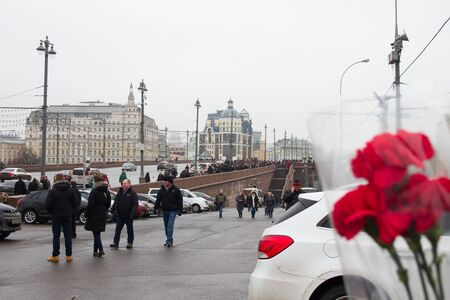 spassky: Moscow, Russia - February 28, 2015. People bring flowers to the site of the murder of politician Boris Nemtsov