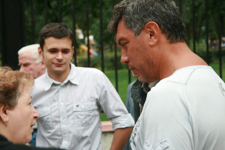 opposition: Moscow, Russia - August 22, 2008. Opposition leader Boris Nemtsov communicate with people during the opposition rally on the anniversary of the events of 1991 in Moscow, when people went out to protest against the coup and won