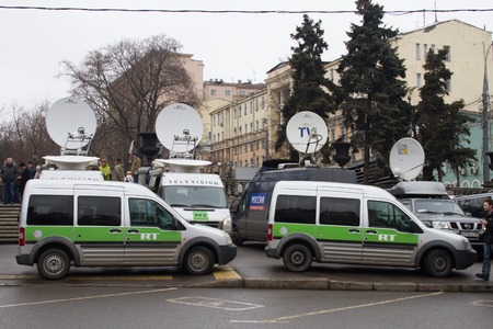 assassinated: Moscow, Russia - March 1, 2015. Buses broadcaster Russia Today near March of the opposition. March to the memory of Boris Nemtsov, Russian opposition leader who was assassinated on the eve of Editorial