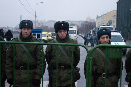 opposition: Moscow, Russia - March 1, 2015. Soldiers of internal troops near opposition March. March to the memory of Boris Nemtsov, Russian opposition leader who was assassinated on the eve of