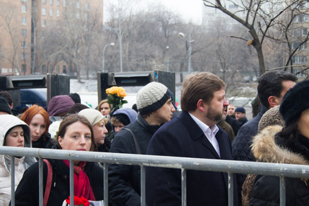 ecologist: Moscow, Russia - March 3, 2015. Ecologist Alla Chernyshova and Governor Nikita Belykh in the queue at the funeral of Boris Nemtsov. Farewell to the oppositionist Boris Nemtsov, who was killed near the Kremlin Editorial