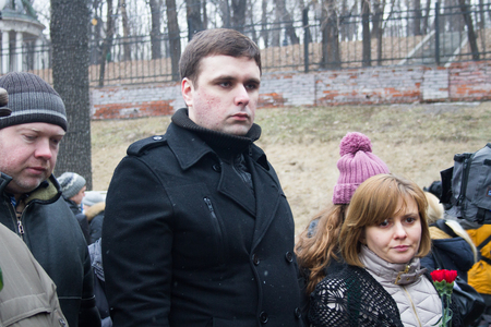 farewell party: Moscow, Russia - March 3, 2015. Opposition politician Konstantin Jankauskas with his wife at the funeral of Boris Nemtsov. Farewell to the oppositionist Boris Nemtsov, who was killed near the Kremlin