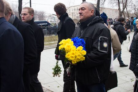 farewell party: Moscow, Russia - March 3, 2015. Flowers in the color of the flag of Ukraine at the unknown in the queue at the funeral of Boris Nemtsov. Farewell to the oppositionist Boris Nemtsov, who was killed near the Kremlin