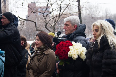 political prisoner: Moscow, Russia - March 3, 2015. journalist Yulia Taratuta and former political prisoner Platon Lebedev in the queue at the funeral of Boris Nemtsov. Farewell to the oppositionist Boris Nemtsov, who was killed near the Kremlin
