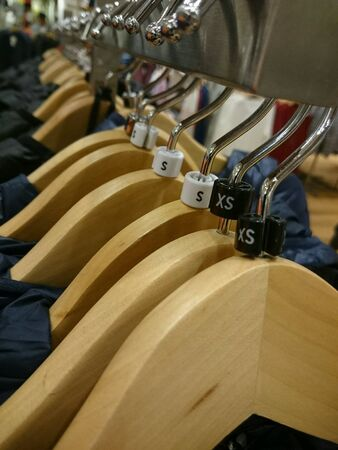clothing: Hangers in a clothing store