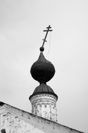 atheism: Falling cross destroyed the old Orthodox Church of the black and white background religion Christianity Stock Photo