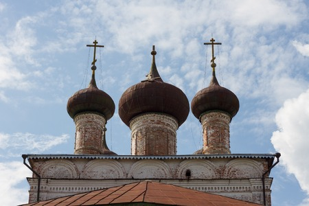 atheism: Three crosses, one in the center fell old building of the Orthodox Church religion Christianity background Stock Photo