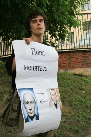 political prisoner: Moscow, Russia - June 4, 2009. Political activist Roman Dobrokhotov to protest in support of Khodorkovsky. Political picket of Solidarity at the building of Hamovnichesky court during the trial of Mikhail Khodorkovsky Editorial