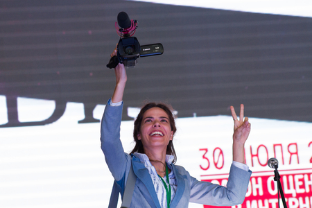 opposition: Moscow, Russia - September 20, 2015. Unknown journalist with a video camera. A Russian opposition rally for democracy. Moscow city area Marino