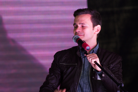 speaks: Moscow, Russia - September 20, 2015. Politician Ilya Yashin speaks at a rally. A Russian opposition rally for democracy. Moscow city area Marino Editorial