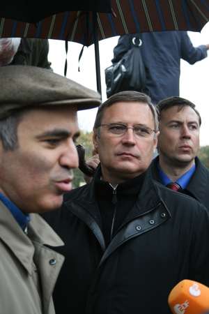mikhail: Moscow, Russia - October 7, 2008. Politician Garry Kasparov interview after the rally in memory of Anna Politkovskaya. In the background politician Mikhail Kasyanov. The rally on the anniversary of the murder of Russian journalist Anna Politkovskaya. On P