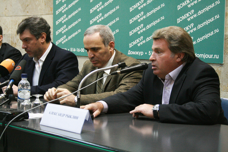 boris: Moscow, Russia - February 6, 2009.  Journalist Alexander Ryklin speaks at a press conference of the Russian opposition. In the frame from left to right politics Boris Nemtsov, Garry Kasparov, Alexander Ryklin