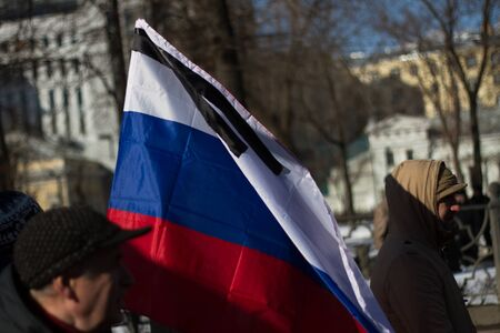 opposition: Moscow, Russia - February 27, 2016. Mourning Russian flag on the March in memory of Nemtsov. March in memory of Boris Nemtsov. On the anniversary of the murder of Russian opposition politician, the opposition held a protest March in Moscow Editorial