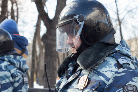 enforcer: Moscow, Russia - February 27, 2016.  Police at the opposition rally in memory of Nemtsov. March in memory of Boris Nemtsov. On the anniversary of the murder of Russian opposition politician, the opposition held a protest March in Moscow Editorial