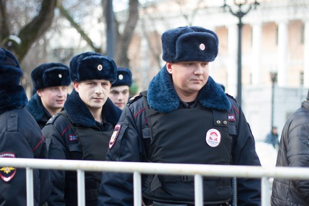 opposition: Moscow, Russia - February 27, 2016.  Police at the opposition rally in memory of Nemtsov. March in memory of Boris Nemtsov. On the anniversary of the murder of Russian opposition politician, the opposition held a protest March in Moscow Editorial